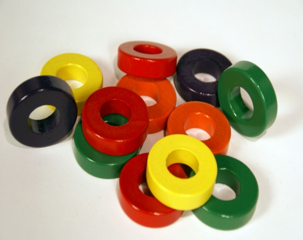 Group of Painted Turned Wood Rings in a Variety of Colors